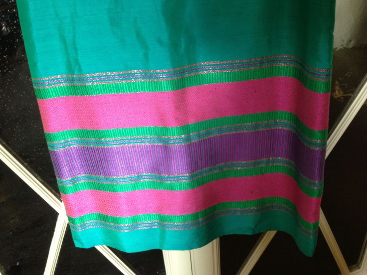 Detail. raw silk fabric long coloured dress from Malaysia