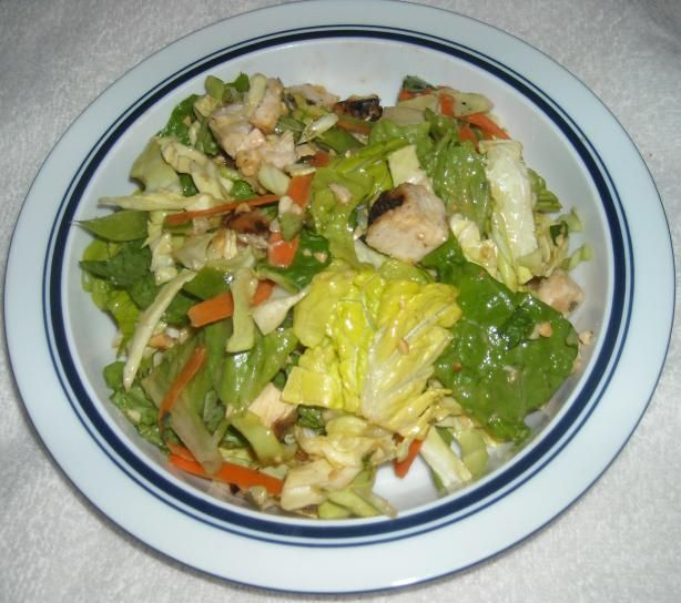 Bobby Flay s Chinese Chicken Salad W/ Red Chile Peanut Dressing from Food.com:   								I saw Bobby Flay make this salad on one of his grilling specials on the Food Network. I made it last night, and wow was it ever delicious. It has become a new family favorite and is great for those who like a little spiciness with a nice crisp, cool salad. It is really easy to make and VERY easy to eat.