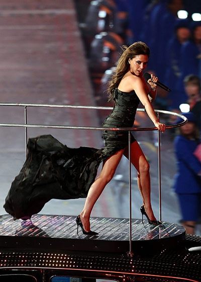 Is she a fashion demi-god? Victoria Beckham played Posh Spice in a custom-made Giles Deacon dress for the night at the London 2012 Olympic Games closing ceremony. Source: Matthew Childs/Action Images
