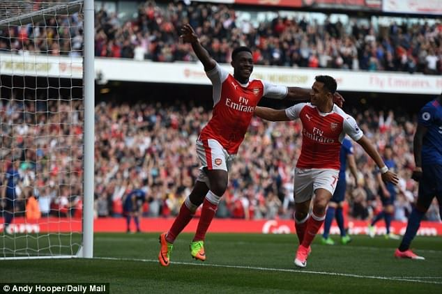 Danny Welbeck celebrates after his header doubled Arsenal's lead against Manchester United for the 2-0 lead. ~ COYG!