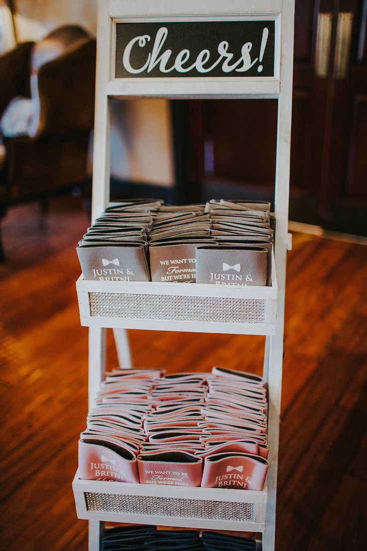 Personalized pink & gray Koozies as guest favors on Cheers stand set out in cocktail hour | Jasmine Amber Photography | villasiena.cc