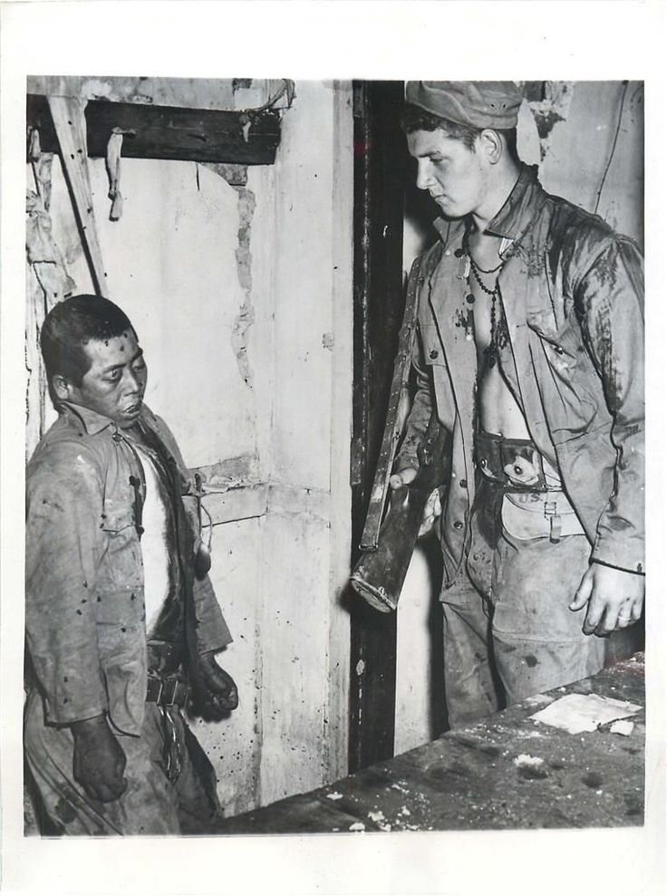 1944- U.S. soldier of Combat Engineer Infantry finds body of a Japanese soldier who committed suicide by hanging himself as U.S. forces entered Myitkyina, Burma.