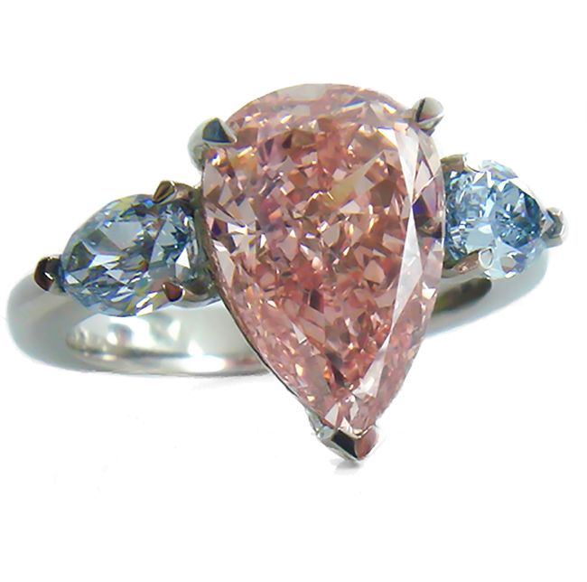 4.06 carat, GIA certified Intense Orangy Pink, Pear shape Diamond with an VS2 clarity. A beautiful Natural Intense Pink Diamond that will looks stunning when set with two Natural Blue Diamonds. This loose diamond has an amazing color. Or you can purchase this diamond set in this gorgeous platinum diamond engagement ring.  Let one of our Diamond Specialist help you.