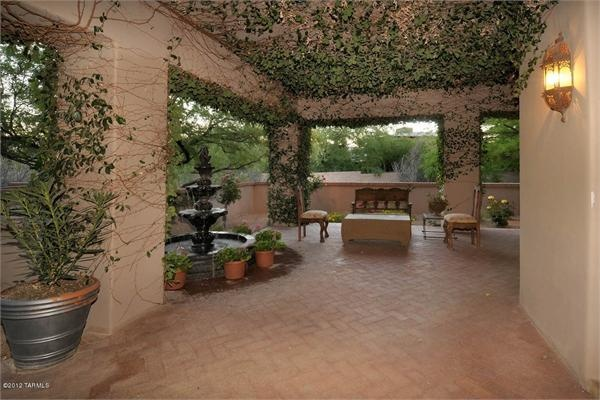 A SPANISH COLONIAL Patio that will work well with Southwest, Mediterranean, Spanish and Mexican homes. From the building materials to the flooring to the decor to the furniture to the types of plants used, this covered backyard patio has some great ideas for a lot of different style homes.