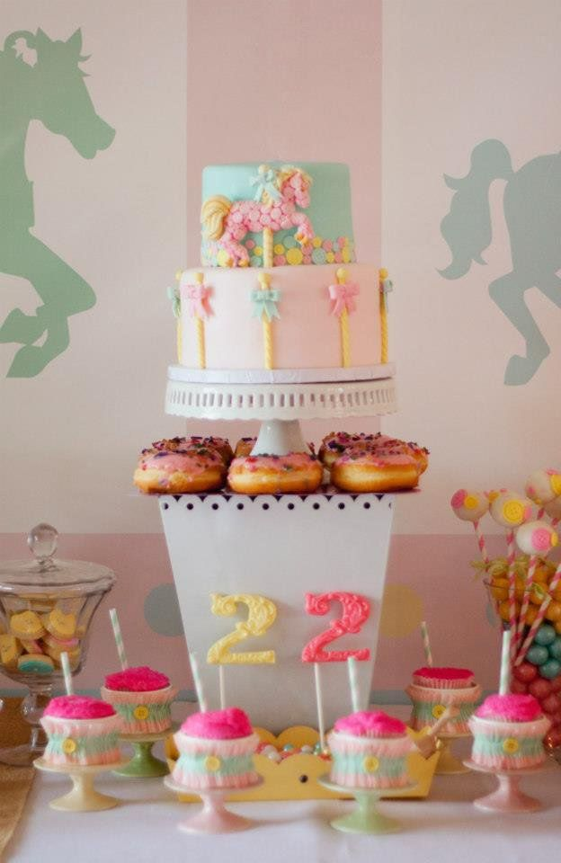 Pin for Later: 70+ Fabulous and Unique Birthday Cakes For Kids A Pastel Carousel Cake This awesome carousel cake and rock-candy-topped doughnuts were just some of the many desserts at this carousel-themed party. Source: Fanciful Events