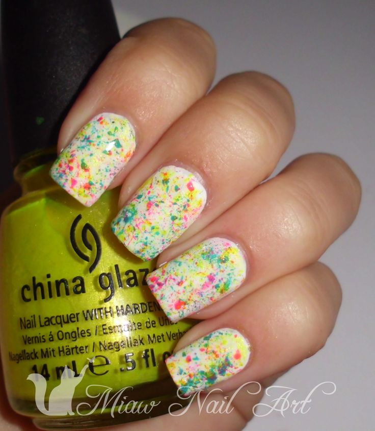 create an artsy splatter effect on your nails using a nail brush and bright neon polishes
