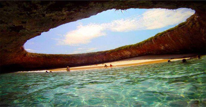 "Hidden Beach in Marieta Islands, Mexico. In the Marieta Islands, about 20 nautical miles from Puerto Vallarta, lies an idyllic beach paradise hidden underneath a hole in the ground. Called the ""Hidden Beach""."