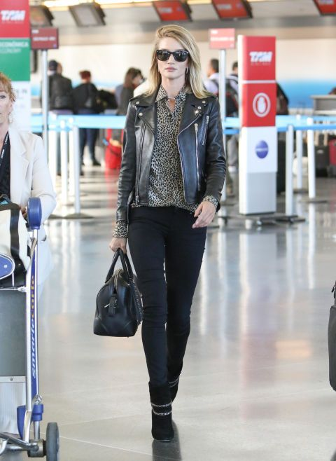 Rosie Huntington at JFK airport. See more well-dressed jet-setting stars.