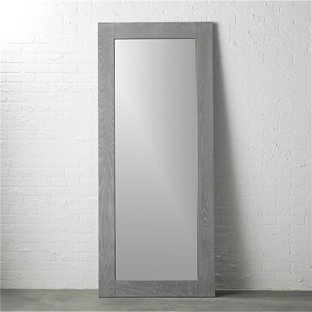 """Shop hanging-leaning grey 32""""x76"""" floor mirror.   Woodsy grey border frames full-length looking glass with tonal texture.  Highlighting active grain at every turn, ash veneer is white washed over grey lacquer."""