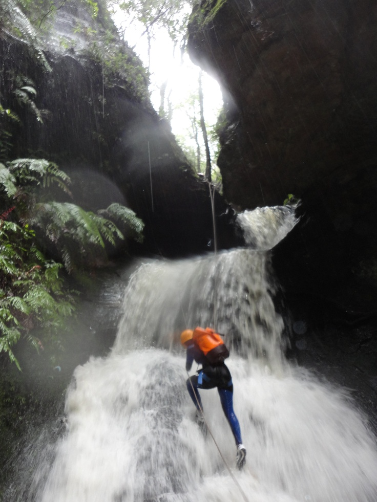This normally fun canyon called Sheep Dip or Twister Canyon is totally full on when it has been raining heavily. A simple climb down using a rope suddenly becomes a serious controlled lower in extremely slippery conditions.
