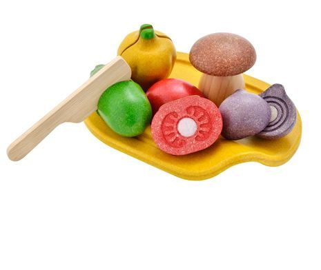 Assorted Wooden Vegetable Set- Your little ones will love preparing a meal with this very cute Assorted Vegetable Set.  The set includes delicious vegies including a tomato, mushroom, shallot, bell pepper & cucumber and also a cutting board and knife. The vegies can be cut in half and put back together with the velcro dots. #woodentoys #plantoys #giftideas #giftsforkids #stockingfillers #playfood