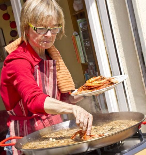 This is Marta, a paella pro who you can learn from on a trip to Barcelona with Travelove