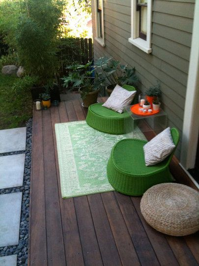 A narrow wood deck outside the back door instead of concrete pad.