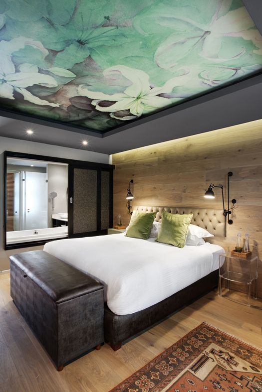 Boutique Hotel | Ceiling wallpaper | Flowers | Wall cladding | Lampe Gras | Bulkhead | Oak | Interior design | Etienne Hanekom Interiors