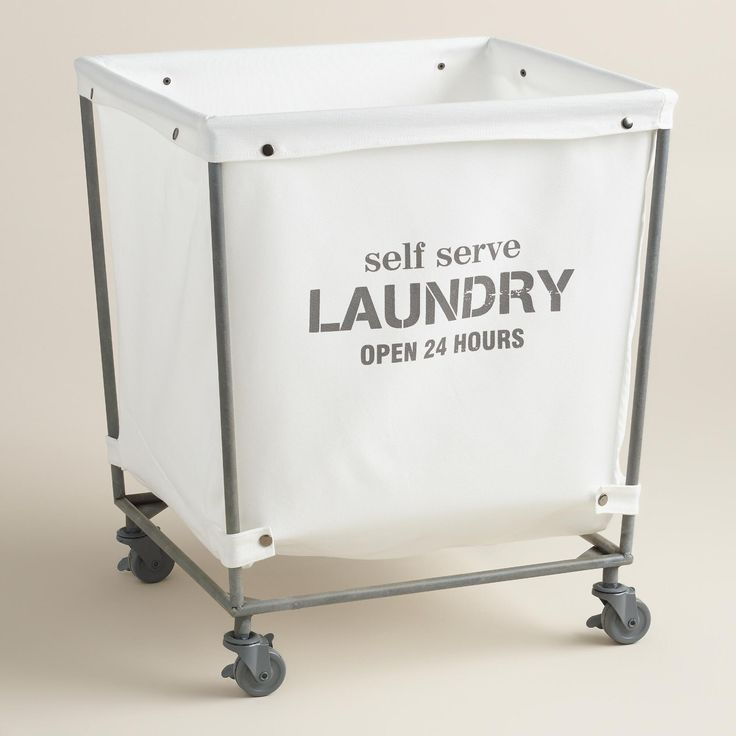 "A chic take on the classic laundromat cart, our rolling hamper features a removable cotton bag that reads ""self serve laundry open 24 hours"" and snaps neatly onto its metal frame. Swiveling casters make it easy to lock into place or roll to and from the washer. >> #WorldMarket Laundry Shop"