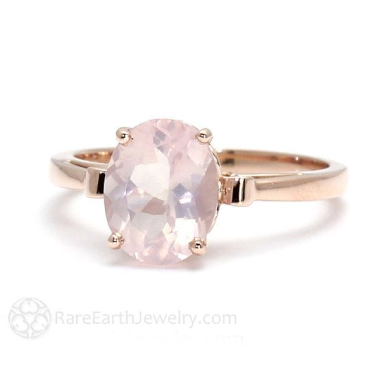 A pretty natural Rose Quartz solitaire ring with a lovely fleur de lis design. There are 2.45 carats of Rose Quartz, expertly faceted into an 10 x 8mm