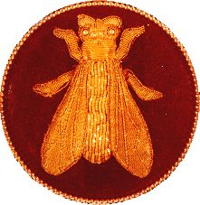 The Bee was Napoleon's symbol. Napoleon had 300 golden bees sewn onto his coronation robe—worn when he crowned himself Emperor of France.