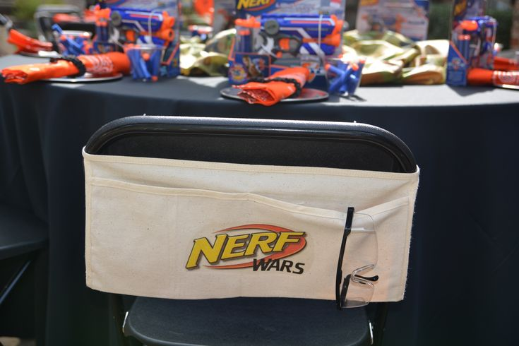 """NERF gun and dart holder made from """"nail belt"""" and free iron on.  Safety goggles from the Dollar Store"""