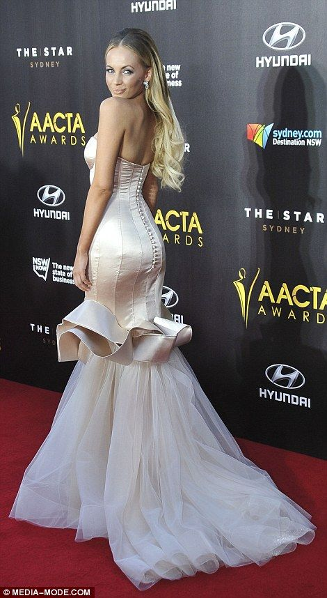 Star on the rise: Samantha Jade stunned as she arrived in Pallas Couture design…