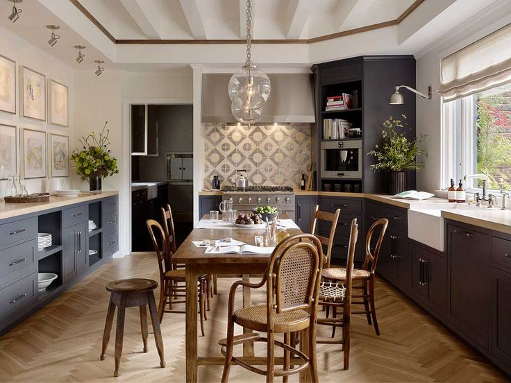 There's a sense of warmth in the contemporary kitchen designed by Alison Davin of Jute Home for the 2013 San Francisco Decorator Showcase. White oak herringbone floors set the tone and are paired w...