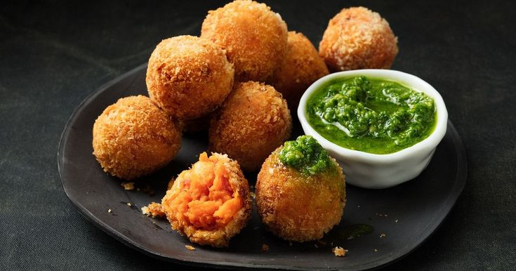 These quick and easy crumbed balls are stuffed full of sweet potato, salami, cheese and pizza sauce.