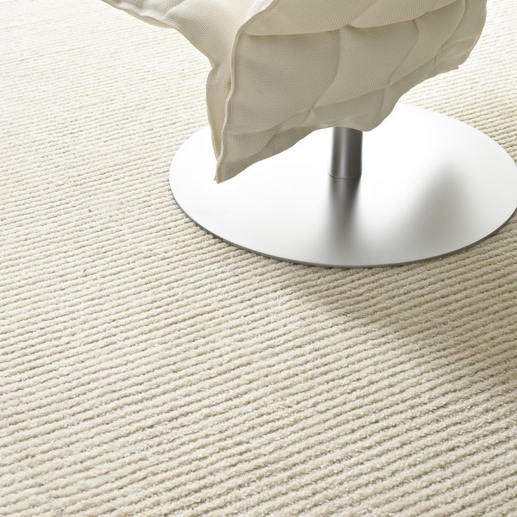 Woodnotes tufted carpet Path has a relief structure; the pile and loop lines vary. Col. white.