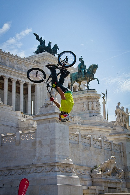 flip    BMX exhibition for Rome's bicycle day. By Piazza Venezia, on Via del Fori Imperiali. Rome, 2012.