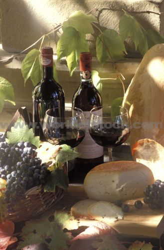 Bottle Of Chianti Wine With Grapes Bread And Cheese At Chateau Uzzano ...