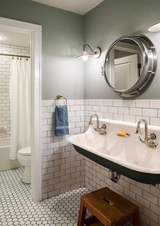 """Soho White subway tile 3 X 6 on wall and Soho White 2"""" hexagons on floor with dark grout"""