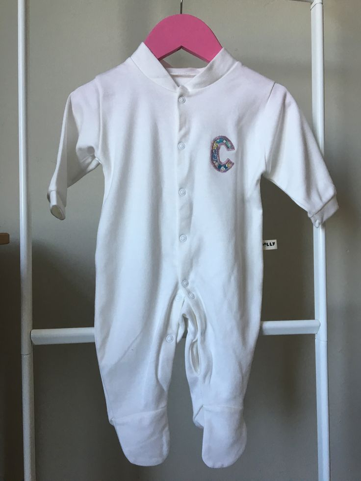 Gorgeous super soft organic cotton cream sleepsuit with popper fastening at the…