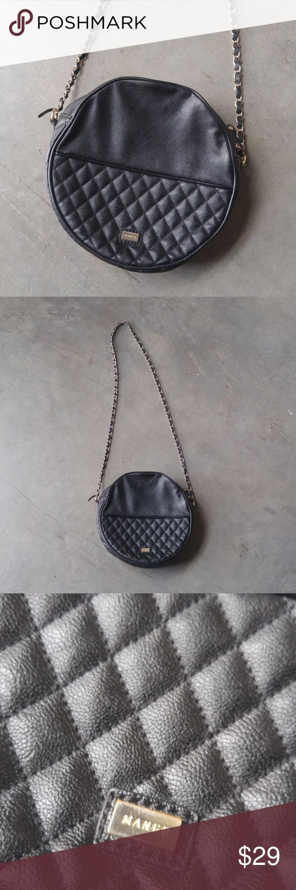 Mango Black Quilted Round Circle Bag Mango brand crossbody bag in excellent condition! Only flaw is the end of the black piece that is weaved through the chain strap needs to be glued back down. Black faux leather material with quilted bottom half on both front and back. A very unique statement piece! Smoke free, pet friendly home. No trades. No modeling. Make a reasonable offer. Thanks! Mango Bags Crossbody Bags