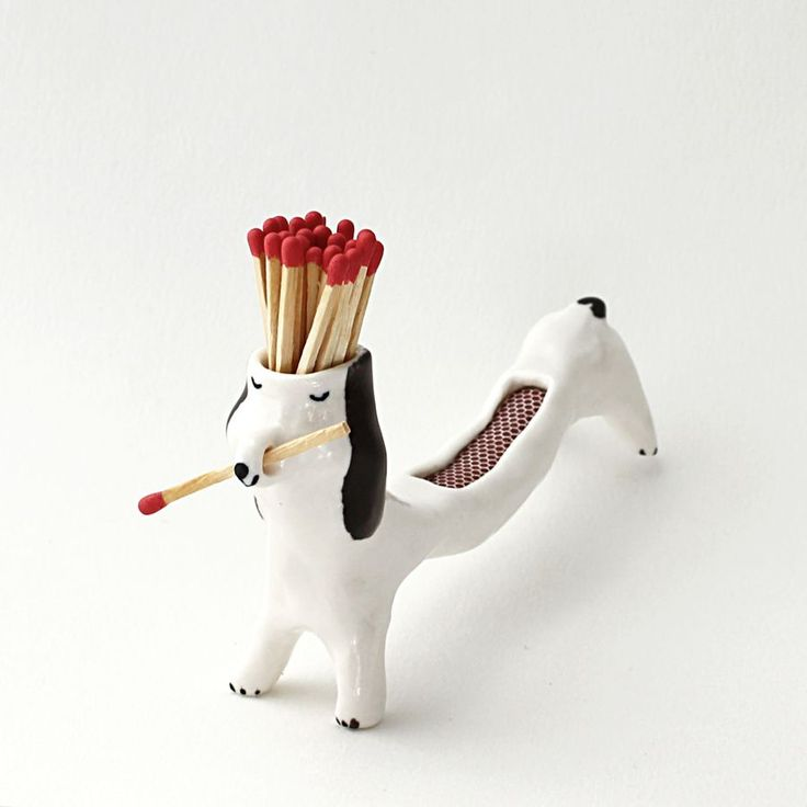 This is a matchstick dog to help you lit you candles when the evening comes.It's a uniquely hand-sculpted dog, made out of paper porcelain, covered with a semi glossy glaze and hand-painted details. He comes with matchsticks ready to use.The dog is about 7 cm high and 13,5 x 3 cm wide and weighs 90 g.