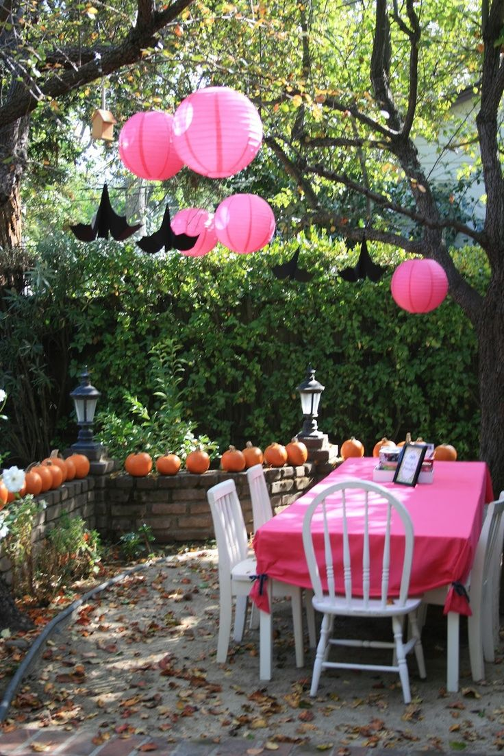 28 wonderful outdoor halloween party ideas outdoor halloween party with pink white wooden tabel chair lantern and pumpkin ornament - Outdoor Halloween Party