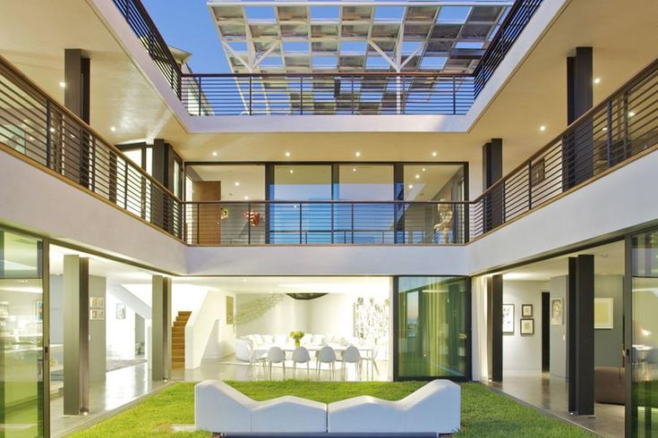 Modern U Shaped House Design Plans w/ courtyard:  In Or Out? – This semi-covered grassy courtyard is the perfect place to escape to for some fresh air, but the partial roof covering prevents the area from feeling overly exposed. Image: newtheme.net