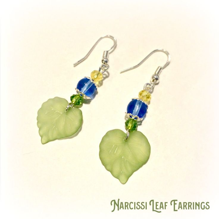 Bluebell blue and narcissi yellow leaf earrings. Yellow and green cut glass beads with bluebell blue bead and green lucite leaf bead.
