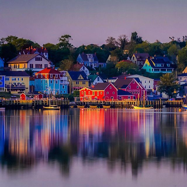 Sunset over the colourful fishing village of Lunenburg, Nova Scotia. The town of Lunenburg is a UNESCO World Heritage site and is a place you cannot miss on the south shore of Nova Scotia. If you drive to the opposite side near the golf course you get a beautiful view of the harbour. (credit: theplanetd via instagram)