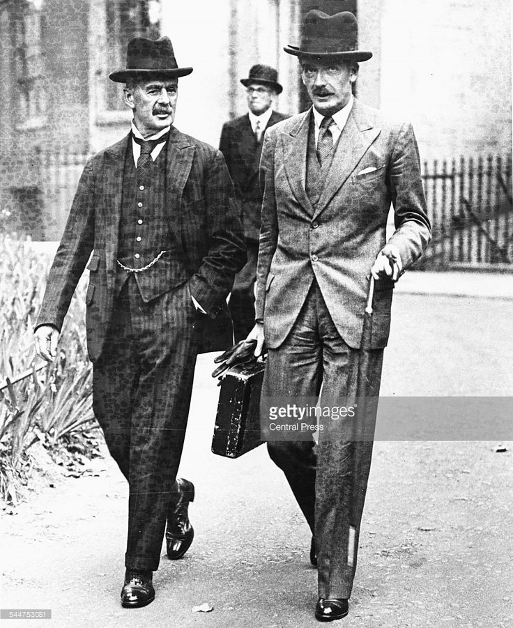 Foreign Secretary Sir Anthony Eden (right) with Neville Chamberlain, Leader of the Conservative Party, both favoring a Homburg at as they walk together in London, 1937. Printed following the death of Lord Avon on January 14th 1977.