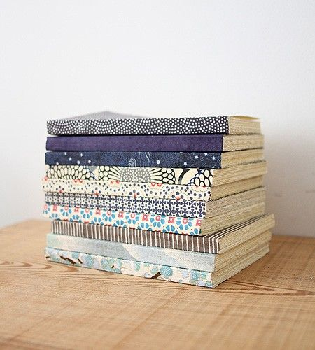 Brookfarm Notebook collection - These beautiful notebooks are handmade for us in France. The cover is dark blue, hand-printed Japanese paper with a delicate spiral white dot pattern. With heavy, acid free Italian Fabriano laid paper inside. With a square binding and rough-cut edges. Opens flat.