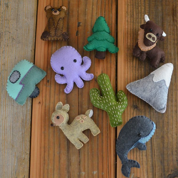 Felt animal mobile for the baby's nursery. I wanted to incorporate all our favorite places so I went with a camping theme; a travel trailer, a cactus to represent the desert, a whale and octopus for the ocean, a bear, deer, bison, evergreen tree and mountain to represent all of our favorite mountain places.