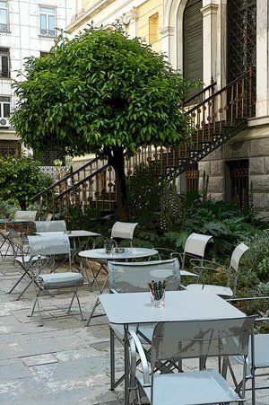 Visit Greece| One of the most friendly places, hidden from the hustle and bustle of the city, where you can take a pause while walking in the center of Athens is the Numismatic Museum garden's small cafe, a five minute walk from Syntagma (Parliament) Square. Even if you don't get to visit the monetary history of Greece via the museum's great collection of coins, enjoy a small coffee or lunch break at its fantastic garden or have a few early drinks as the coffee shop stays open until night.
