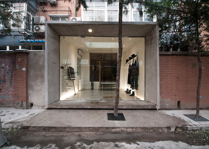 Speys pairs concrete with wood and brass at Beijing boutique