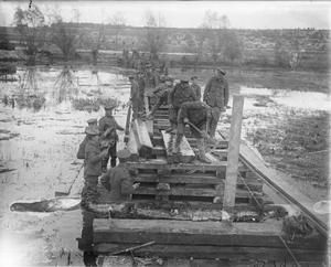 WWI, 7 Nov 1916, Somme; Royal Engineers bridging the Ancre River swamps at Aveluy. ©IWM