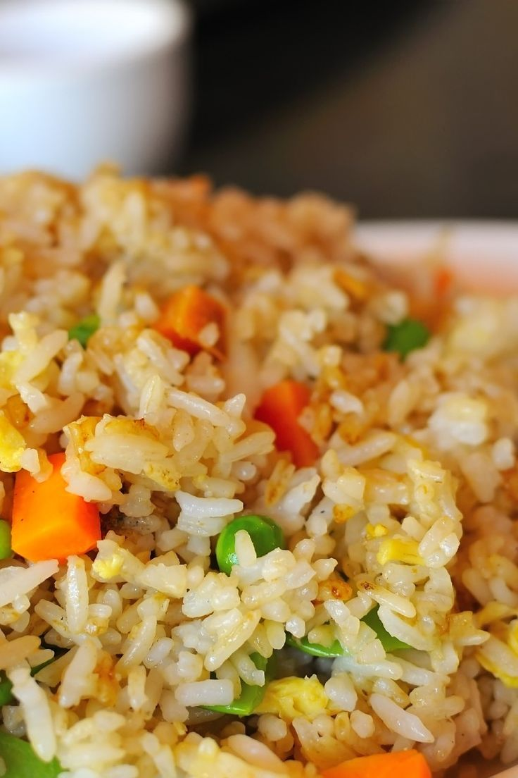 Course(s): Entrée; Ingredients: baby carrot, egg, green peas, sesame oil, soy sauce, vegetable oil, water, white rice