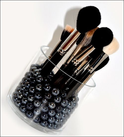 DIY: 14 Cool Make-up Brush Storage Ideas. There are some cool ideas on this blog, I like this one. I thinking a beta fish bowl with black marbles.: