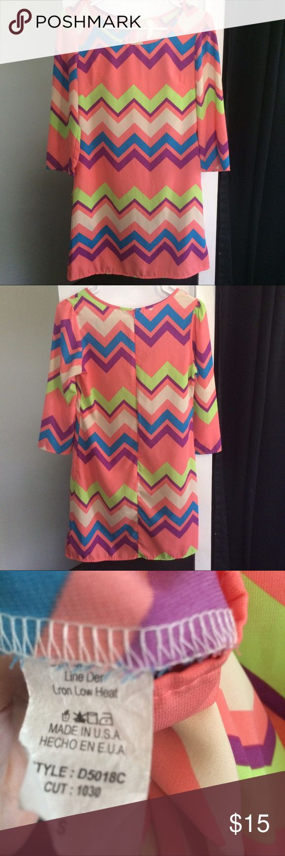Chevron Shift Dress Coral chevron print dress with cream, purple, green, and blue. It zips in the back. Dresses