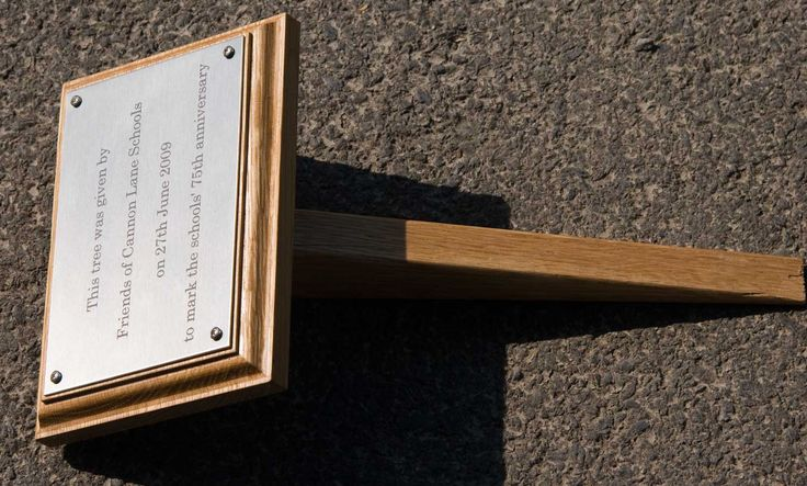 An engraved plaque on a backing board with a small tree stake. www.sign-maker.net/tree-stakes-plaque-holders.html
