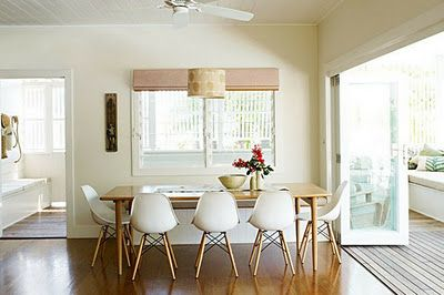Light and airy with Eames replica chairs and mid century Danish dining table.  Nice.