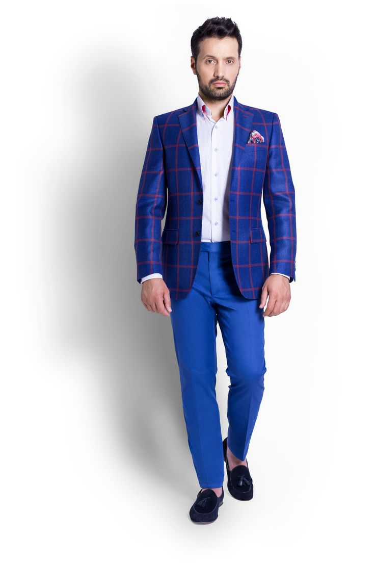 The powerful blue with the red checkers will always be the star of any wardrobe. Combining the jacket with Electric Blue Cotton Trouser and White Shirt with Blue Dots.