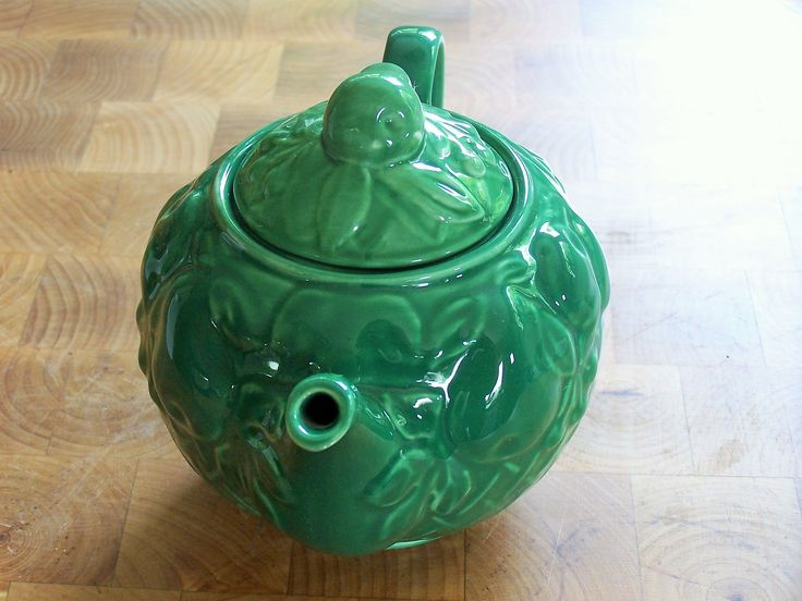 A charming Wade teapot circa the 1950's, bright jade green, in the shape of a basket of fruit - cherries pears, grapes plums etc, and a little pea ...