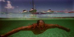 TWA-0005436 © WestPix Australia Day Rottnest Island. John Anderton swims to shore off his yacht in Longreach.